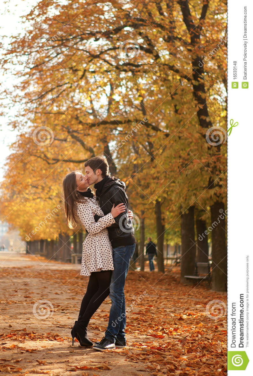 Young beautiful couple at fall