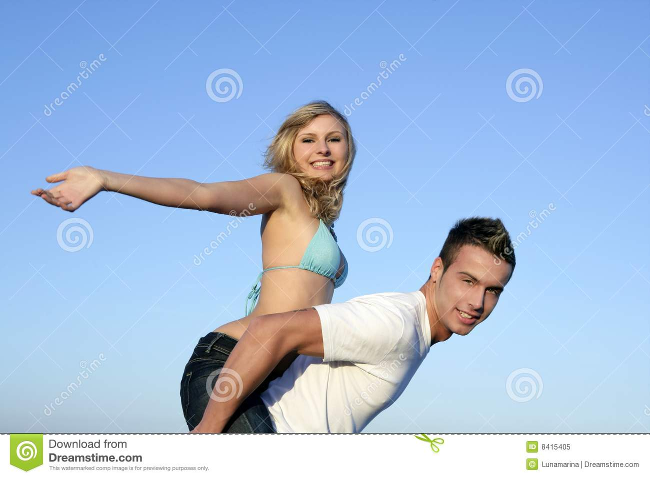 Sorry, young couple play on beach that's something