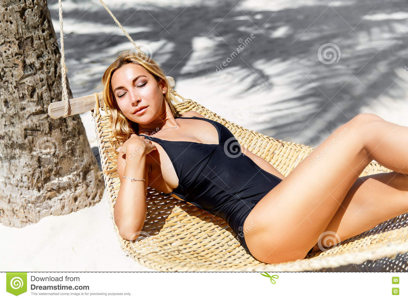 f79cc51ea02cf Young Beautiful Girl In Black Bathing Suit With Long Blonde Hair ...