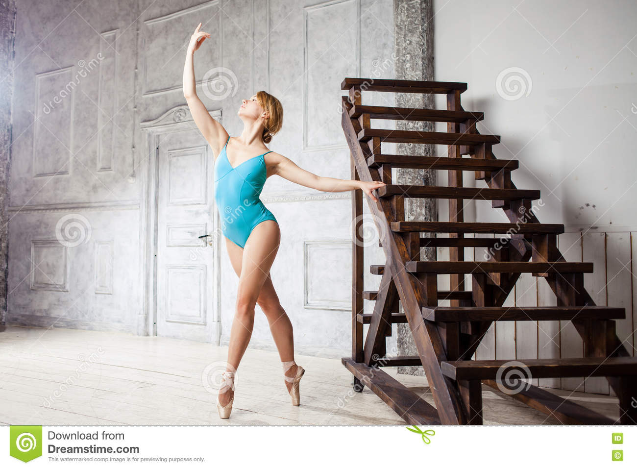 fe364cd43 Young Beautiful Girl In Blue Dance Leotard And Pointe Shoes Stock ...
