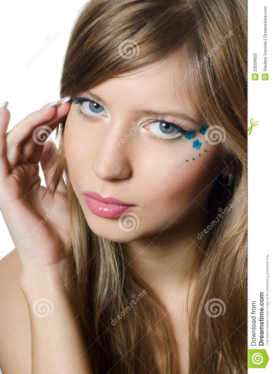 The young beautiful girl with a creative make up stock for Teenage beautiful girls