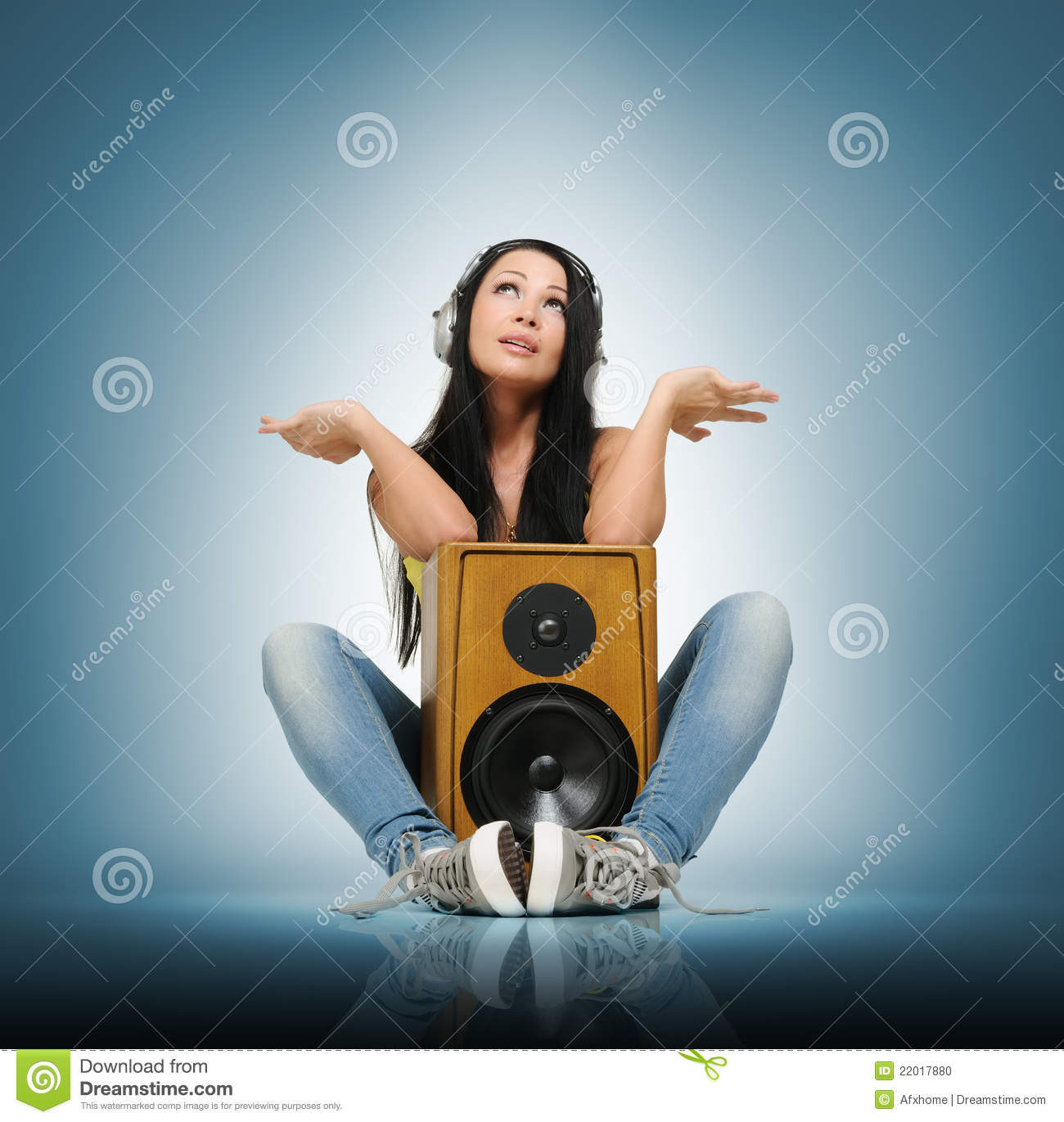 young beautiful girl in headphones with speaker stock