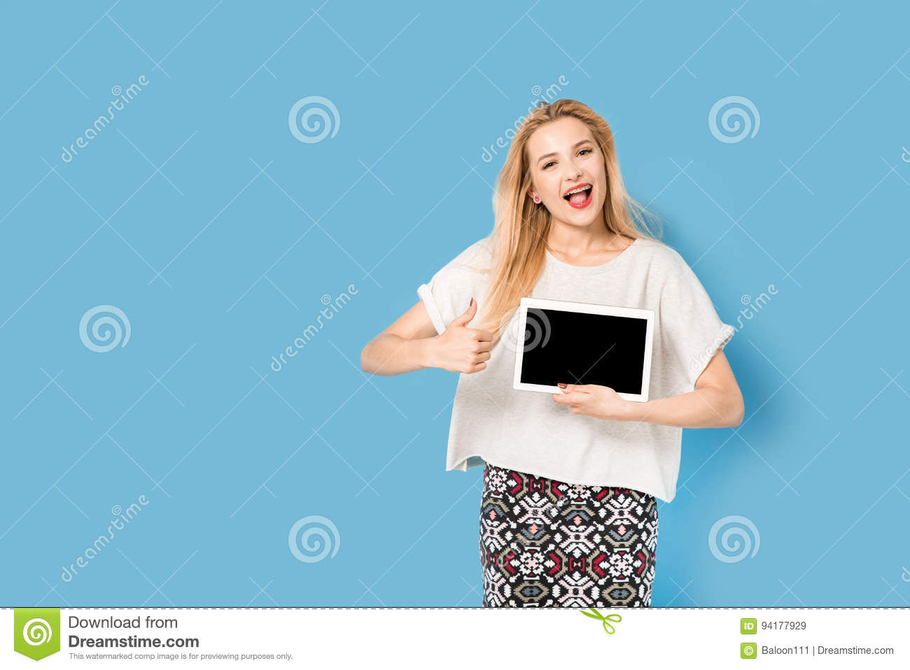 Young beautiful girl with her tablet pc shows