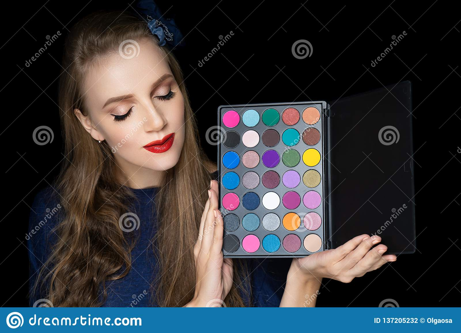 Young beautiful girl holding palette