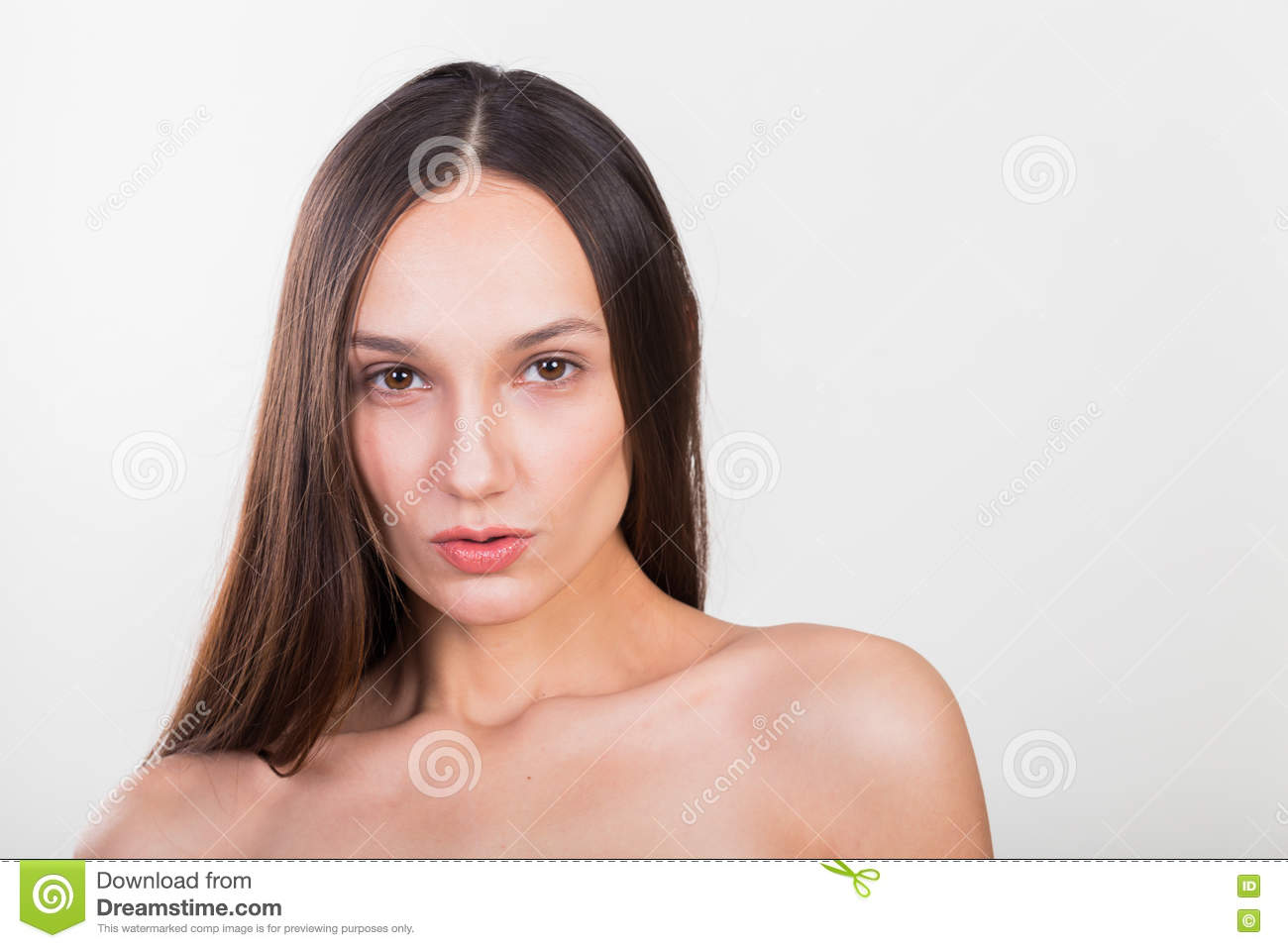 Young beautiful girl on a light background