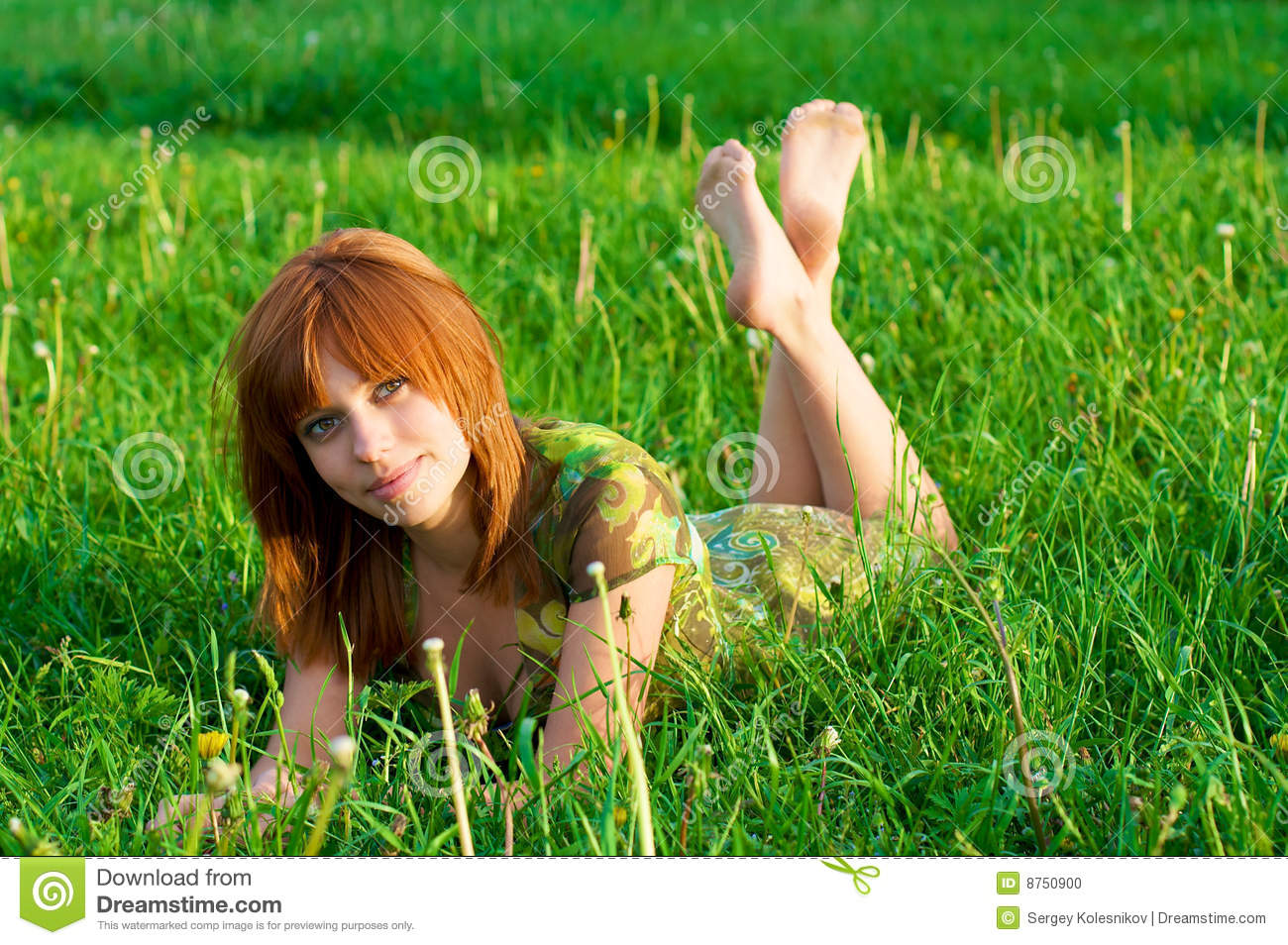 Young beautiful girl lying on the grass stock photo for Pretty grass
