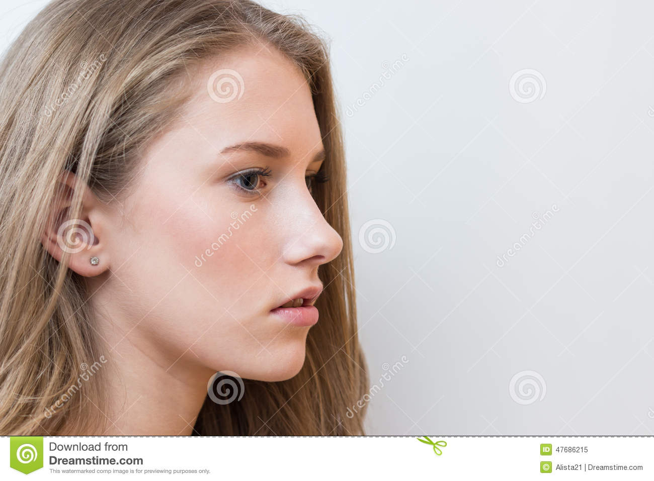 Young beautiful girl side view portrait on white for Teenage beautiful girls