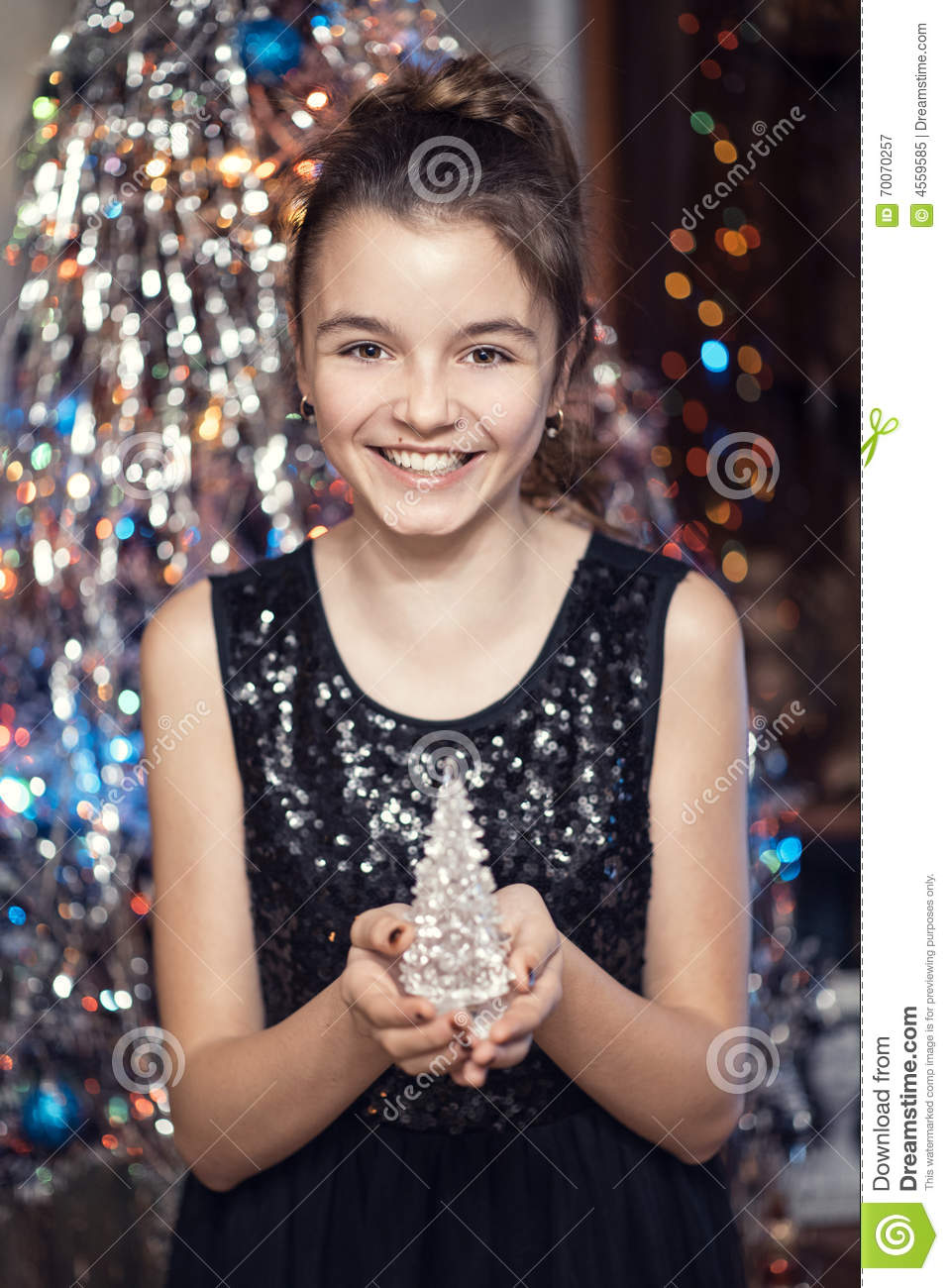 Young Beautiful Girl Smiling And Holding A Christmas Tree
