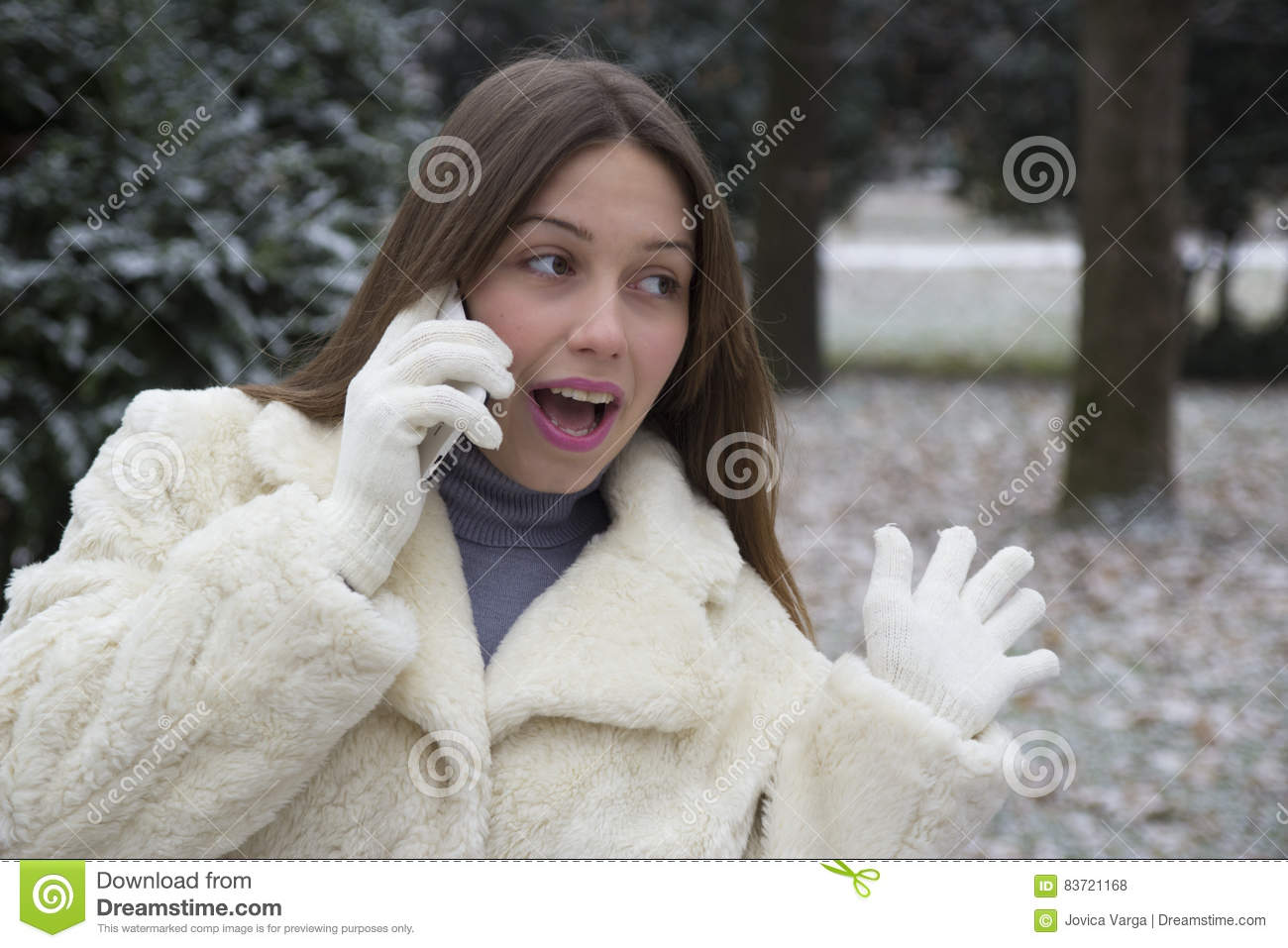 Young Beautiful Girl Talking On A Mobile Phone Stock Photo