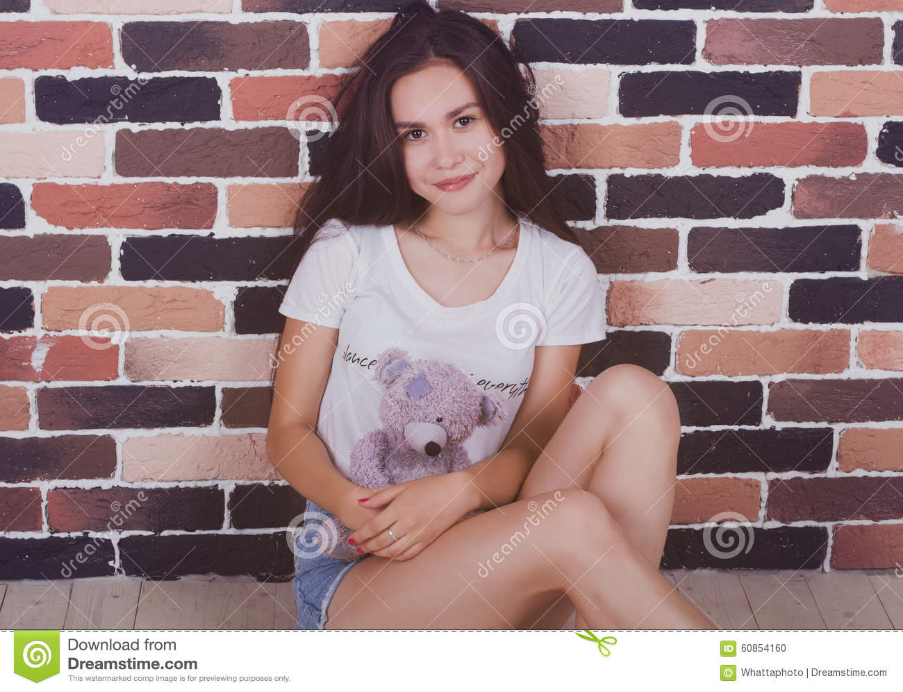 Young beautiful girl with teddy bear