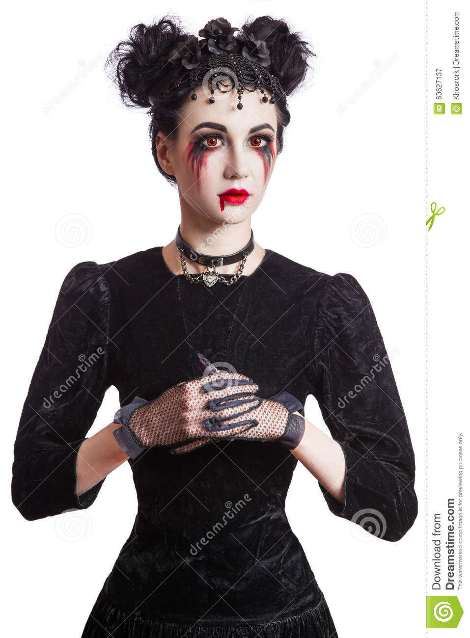 Young beautiful gothic woman with white skin and red lips. Halloween