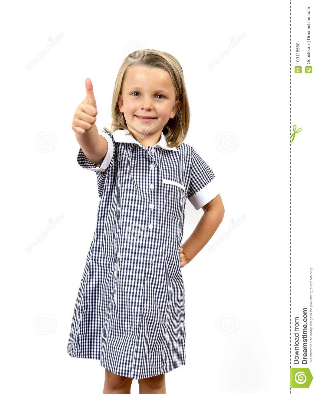 Young beautiful and happy child girl 6 to 8 years old blond hair and blue eyes smiling excited wearing school uniform isolated on