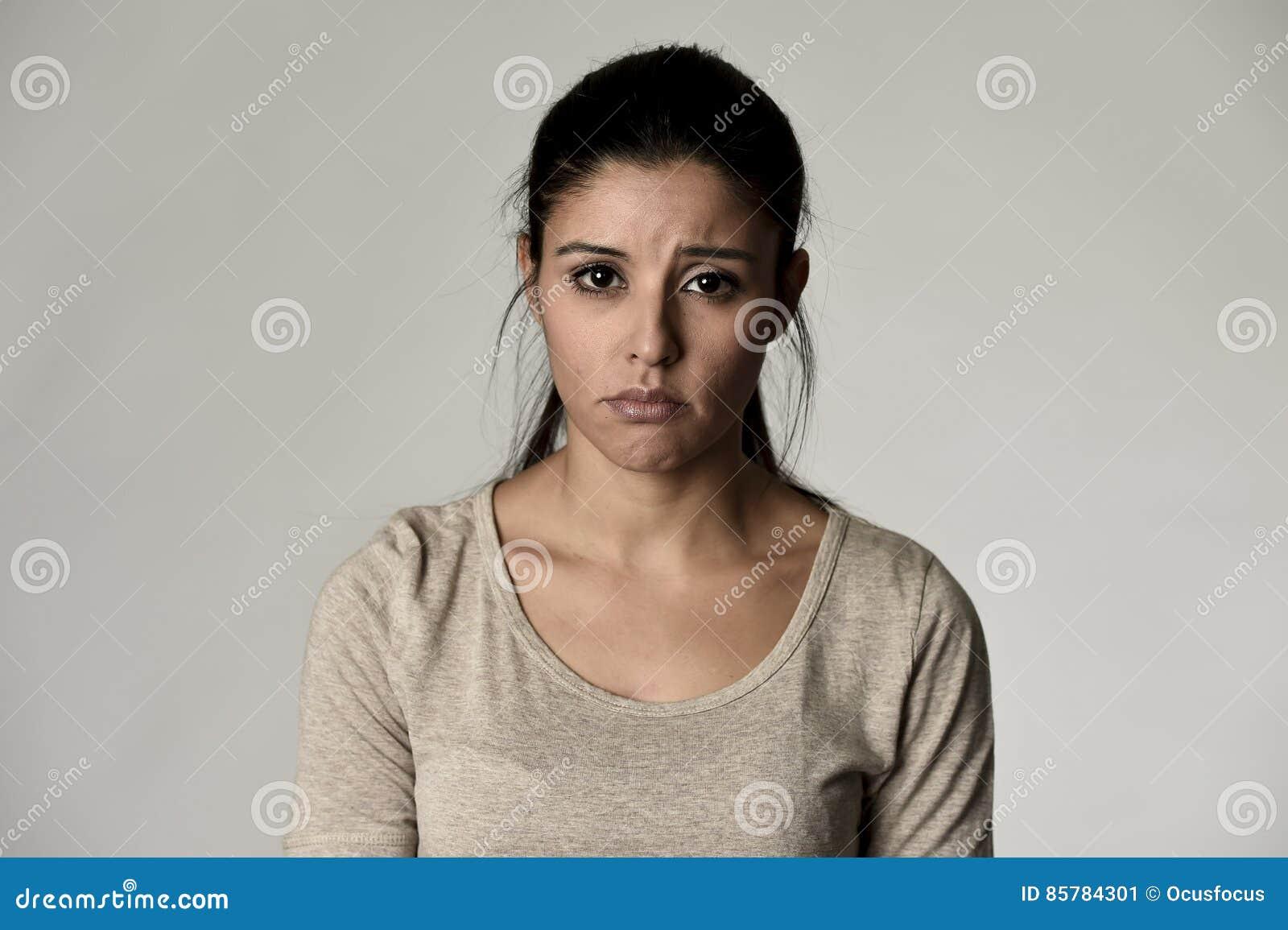 young beautiful hispanic sad woman serious and concerned