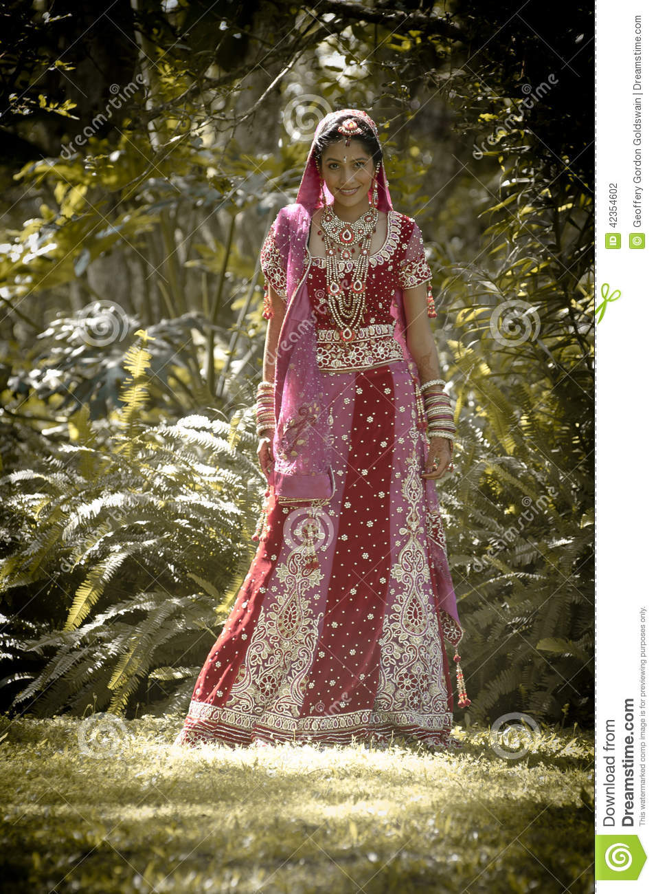 Young Beautiful Indian Hindu Bride Standing Under Tree
