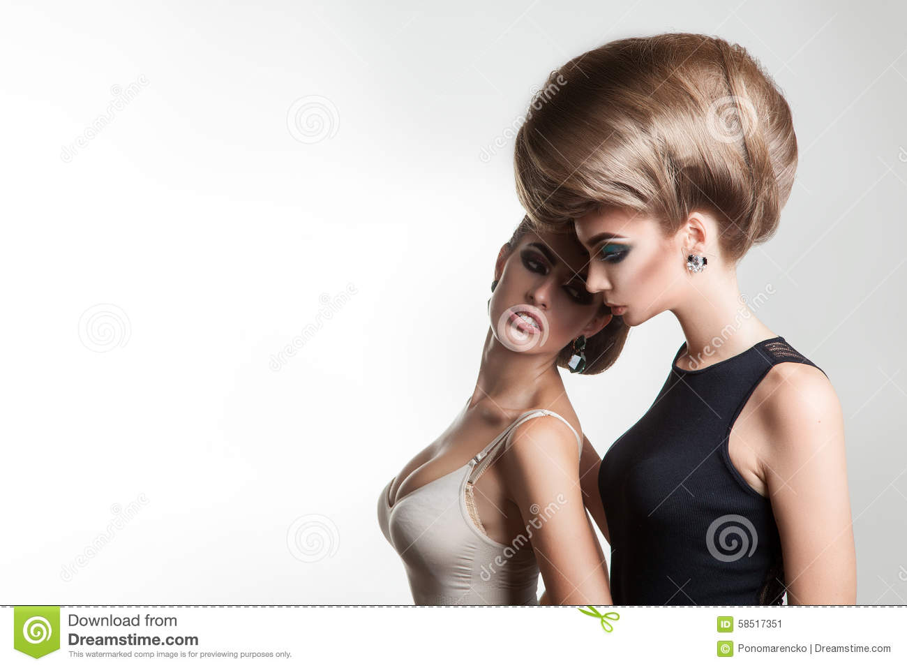 Young beautiful ladies in studio with creative hairstyle
