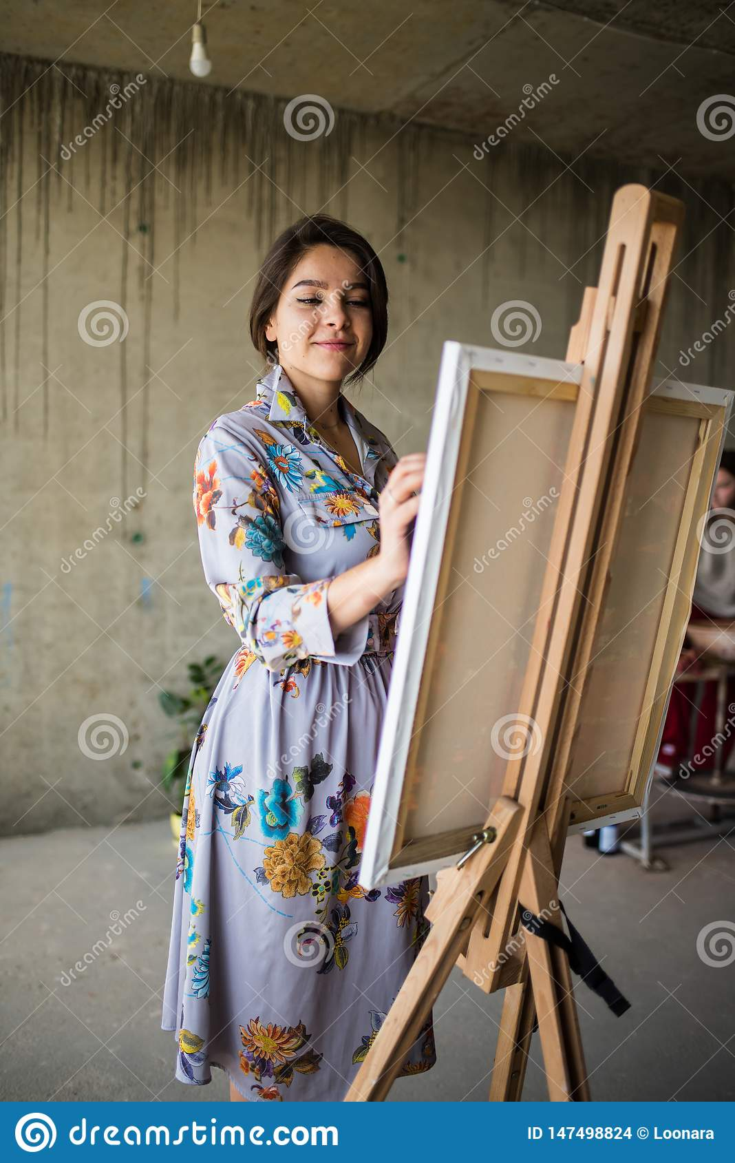 Happy Mature Woman Painting Interior Wall Stock Image