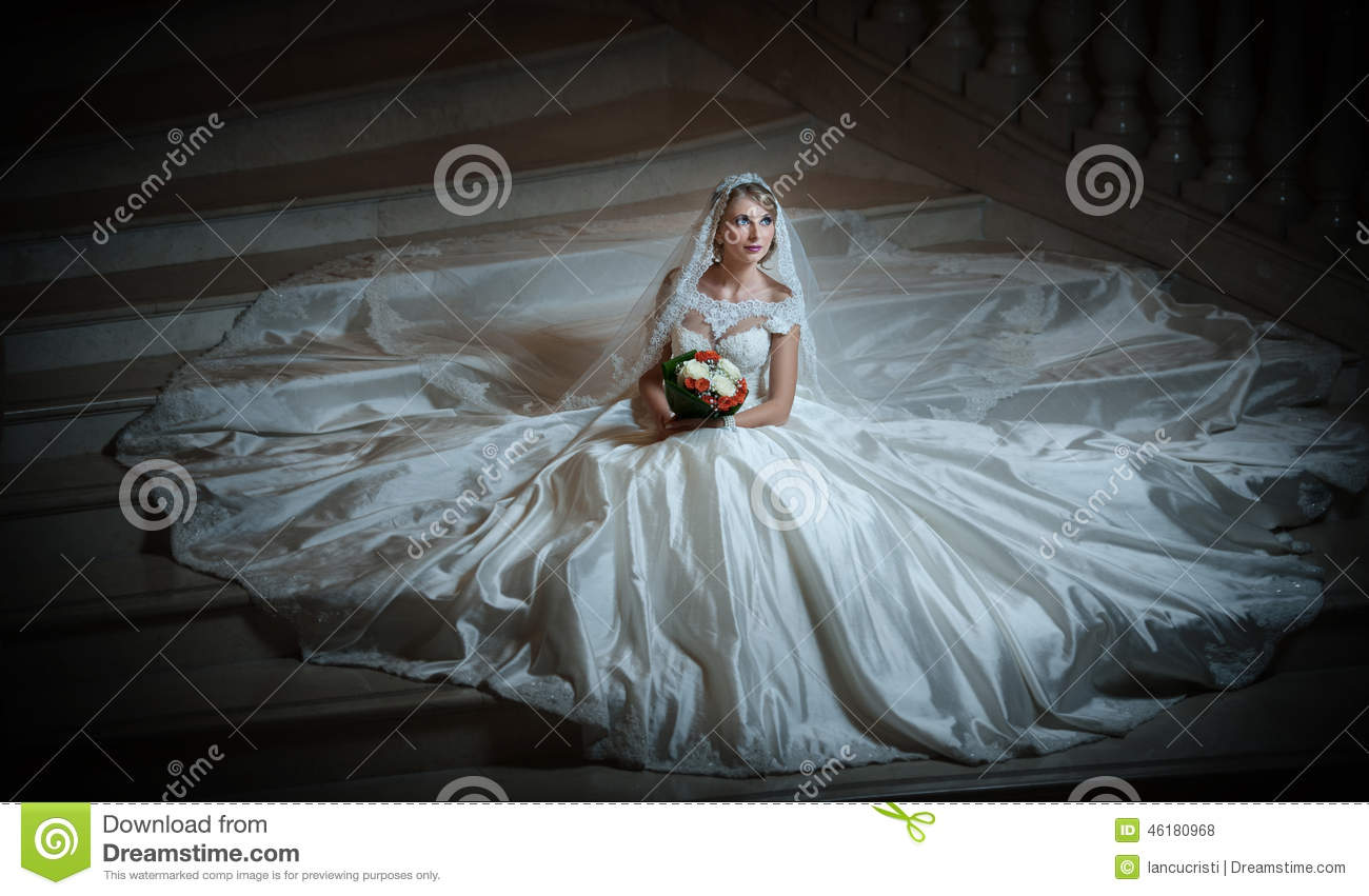 Young Beautiful Luxurious Woman In Wedding Dress Sitting On Stair ...