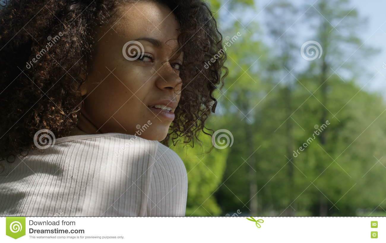 Awesome Beautiful Bathroom Ideas Pictures #5: Young-beautiful-mixed-race-woman-curly-afro-hair-smiling-happily-green-park-portrait-relaxing-portrait-style-71447802.jpg
