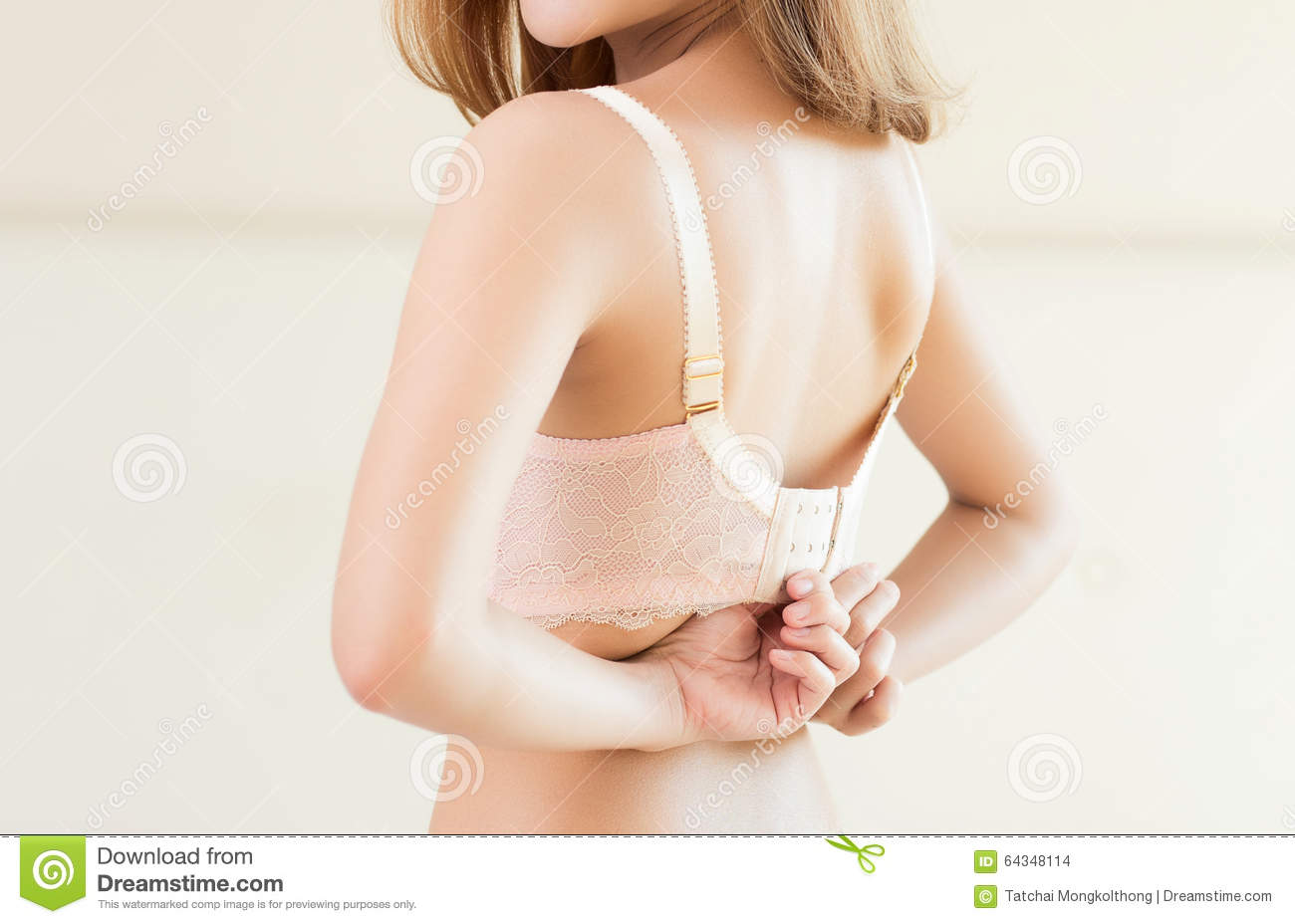 Young Beautiful Model Taking Off Her Bra Stock Photo - Image 64348114-6880