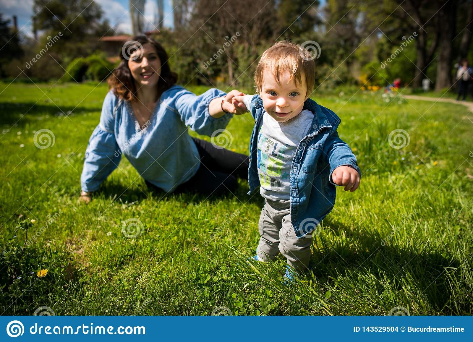 Happy loving family. mother and child playing in the park