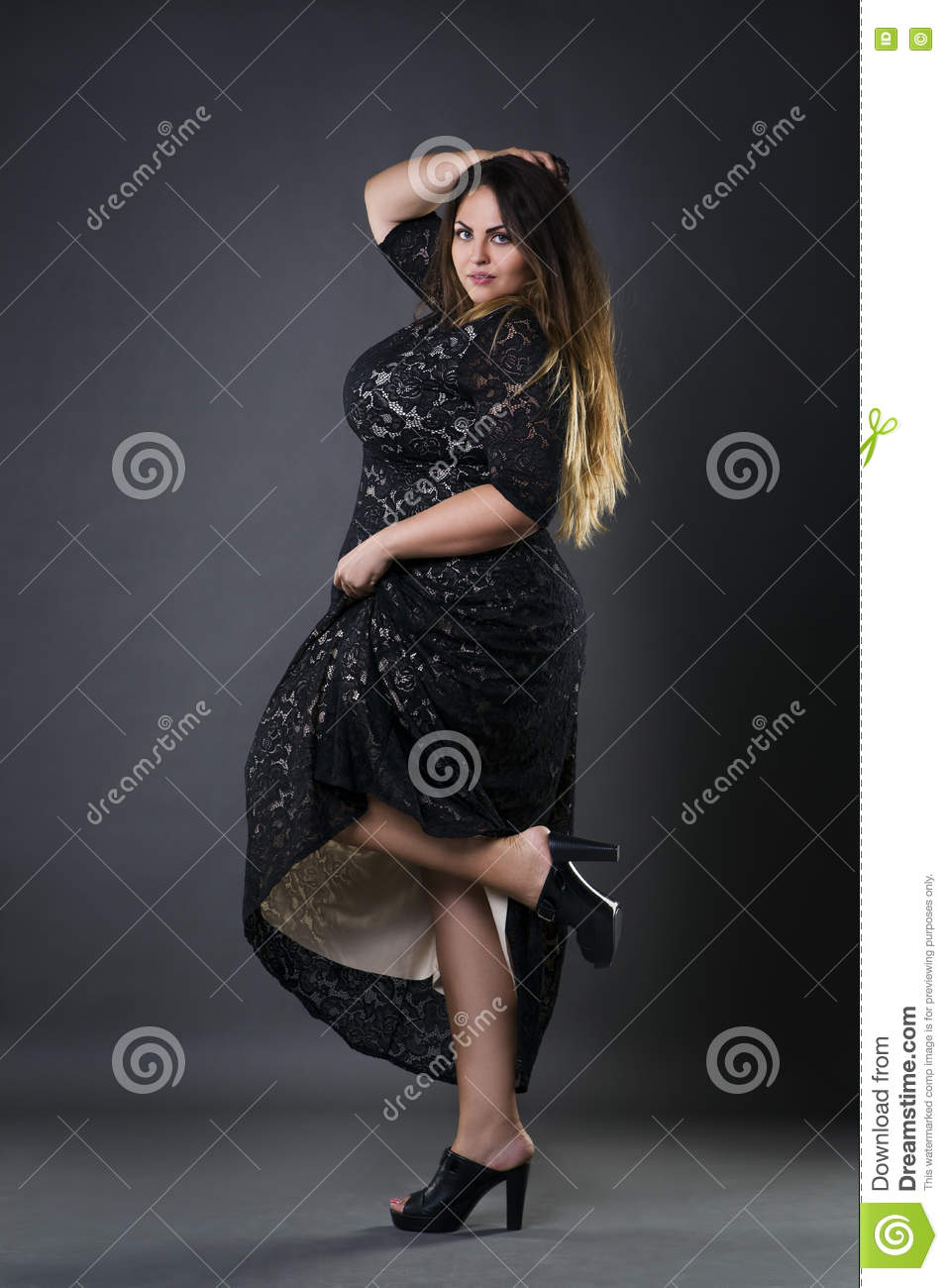 0fd4004d77f Young Beautiful Plus Size Model In Black Dres
