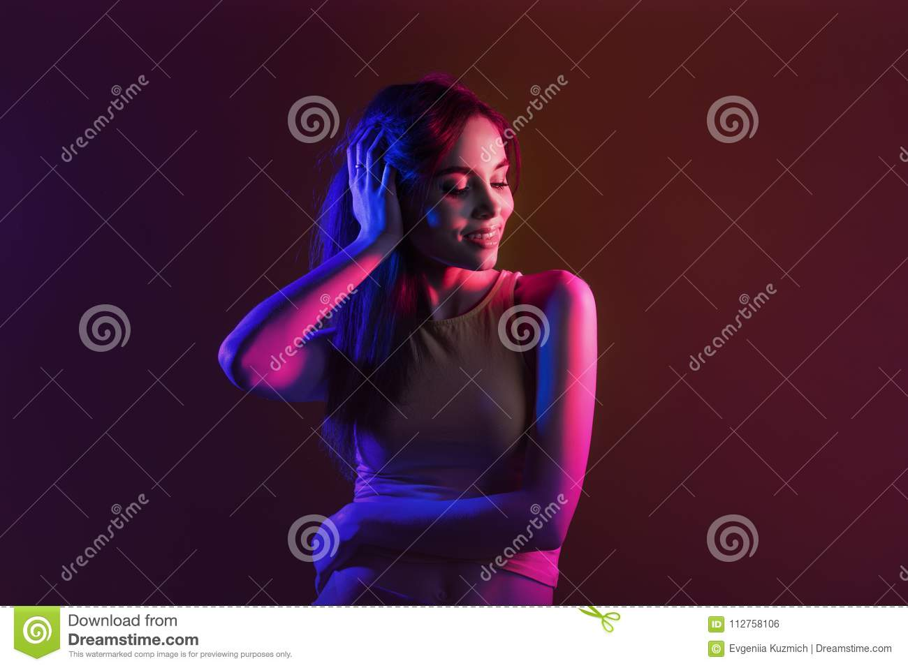 Young beautiful portrait model posing on yellow background in St