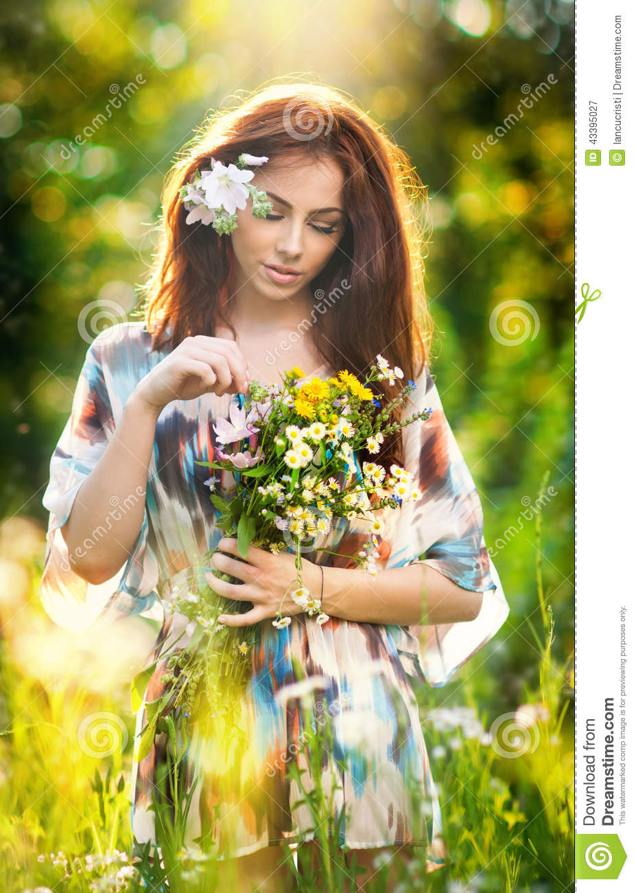 Young beautiful red hair woman holding a wild flowers bouquet in a attractive beautiful bouquet day enjoying female flowers dhlflorist Gallery