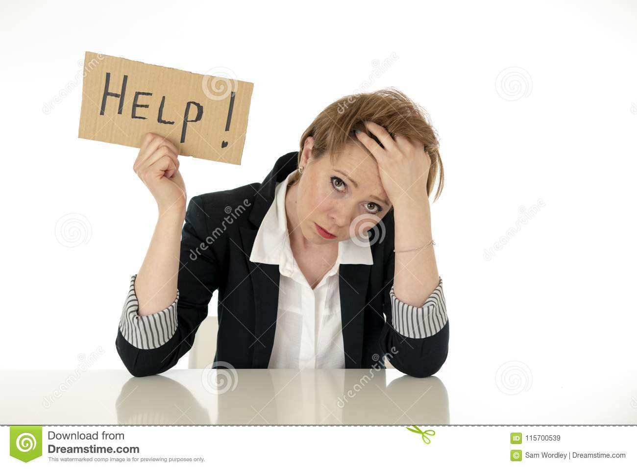 Beautiful young business woman overwhelmed and tired holding a help sign
