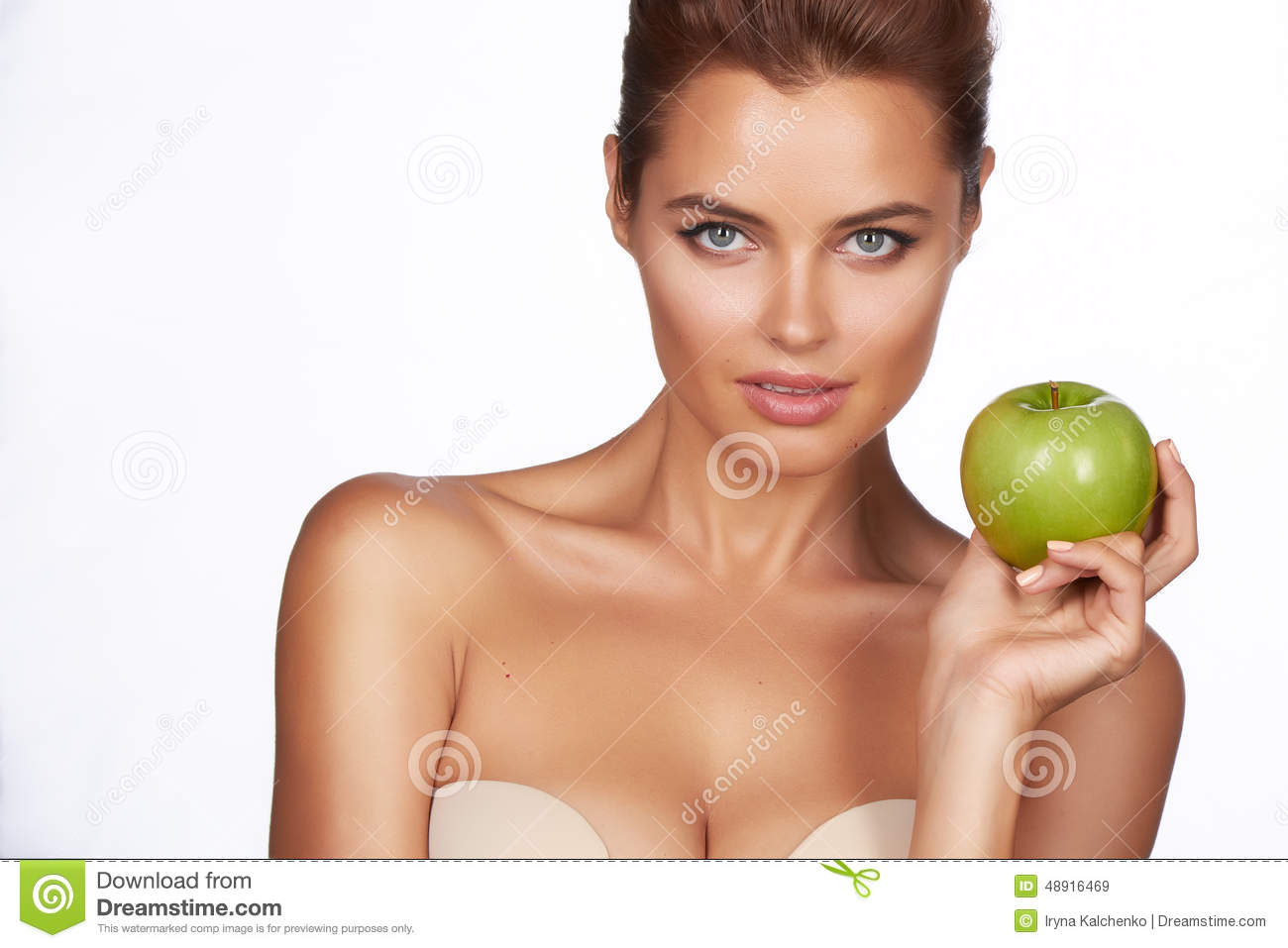 Young Beautiful Girl With Dark Hair Bare Shoulders And Neck Holding Big Green Apple