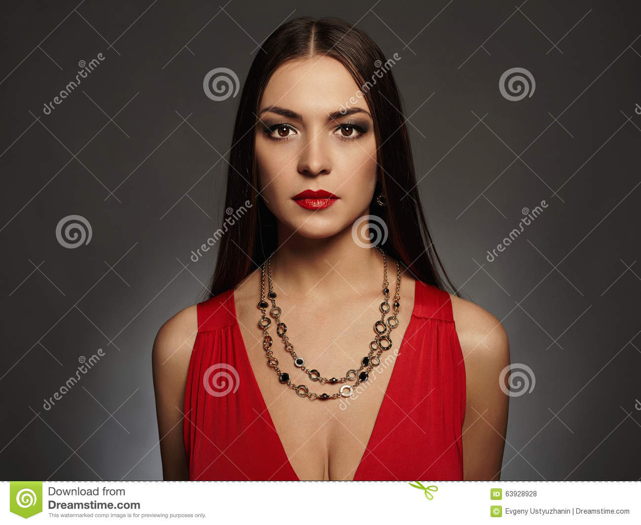 Young beautiful woman.Beauty girl wearing jewelry.elegant lady in red dress