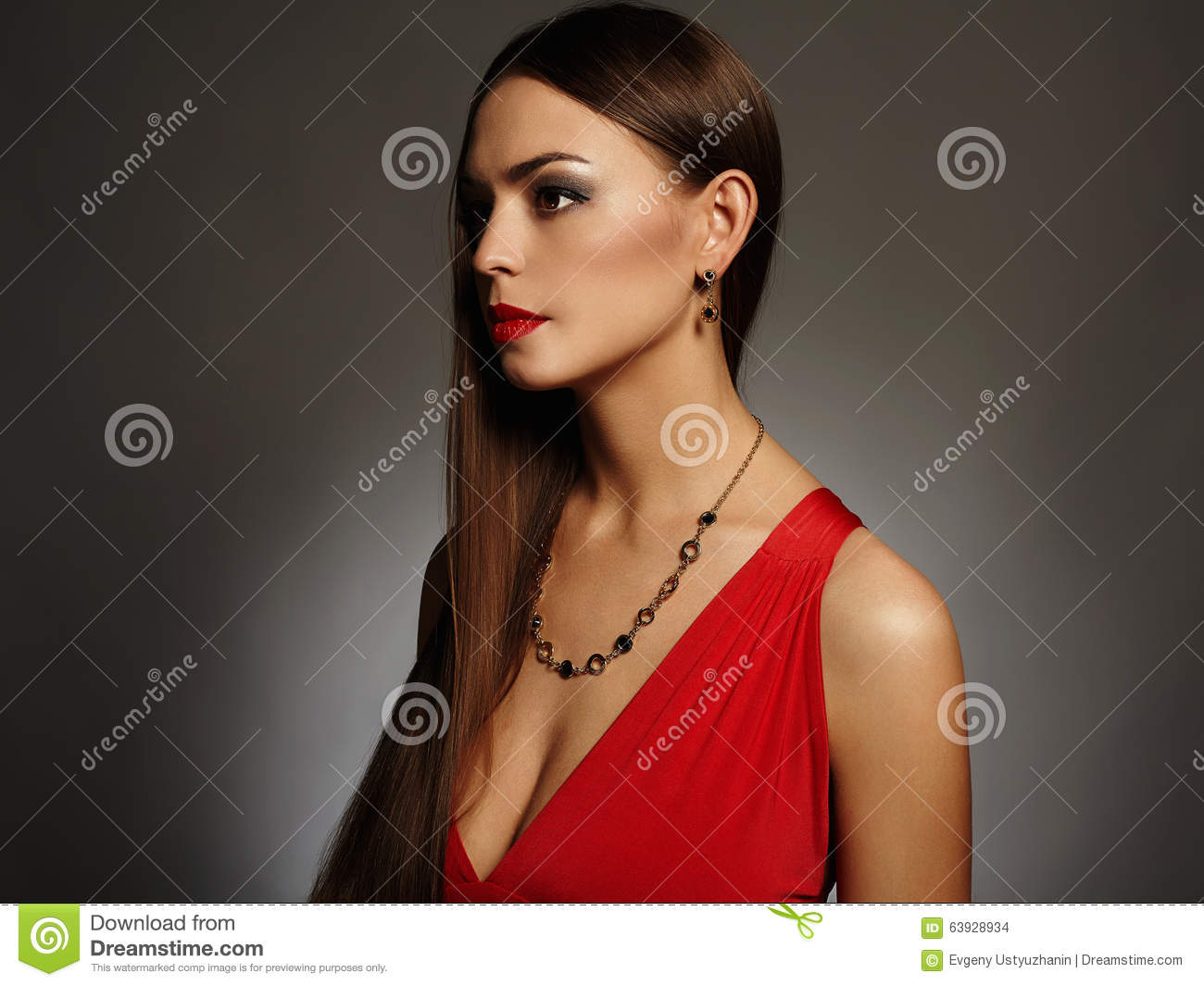 Young Brunette Girl In Fashionable Sexy Red Dress