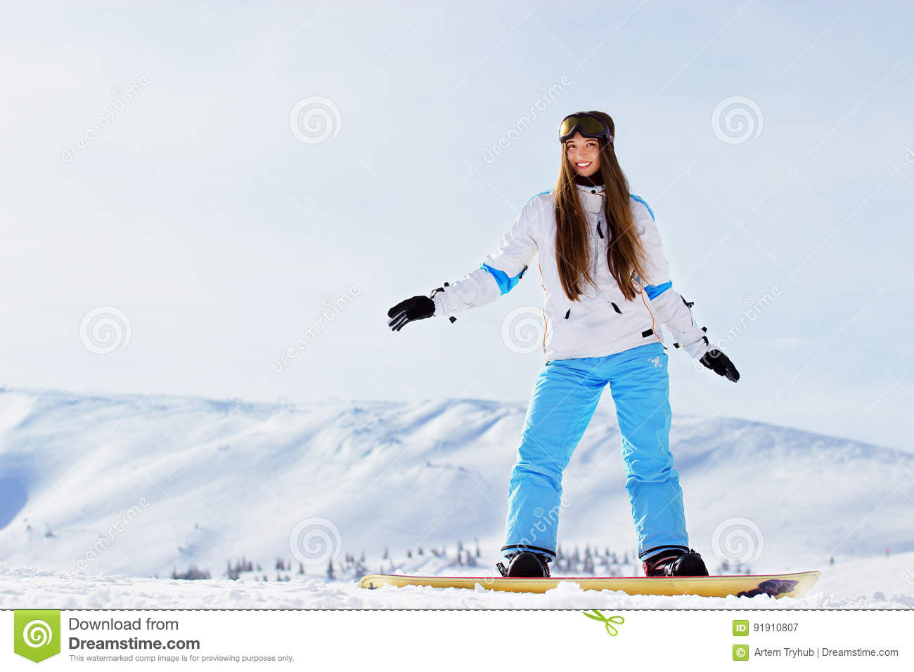 3bbbc46cfa Beautiful woman with snowboard in the mountains. Winter sport activities.