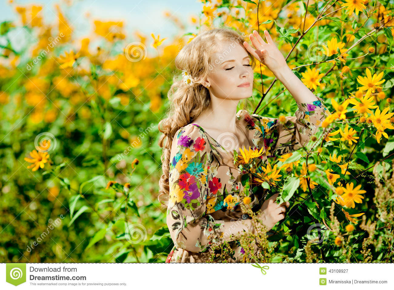 Young beautiful smiling woman in the blooming garden with flower download young beautiful smiling woman in the blooming garden with flower stock image image of izmirmasajfo