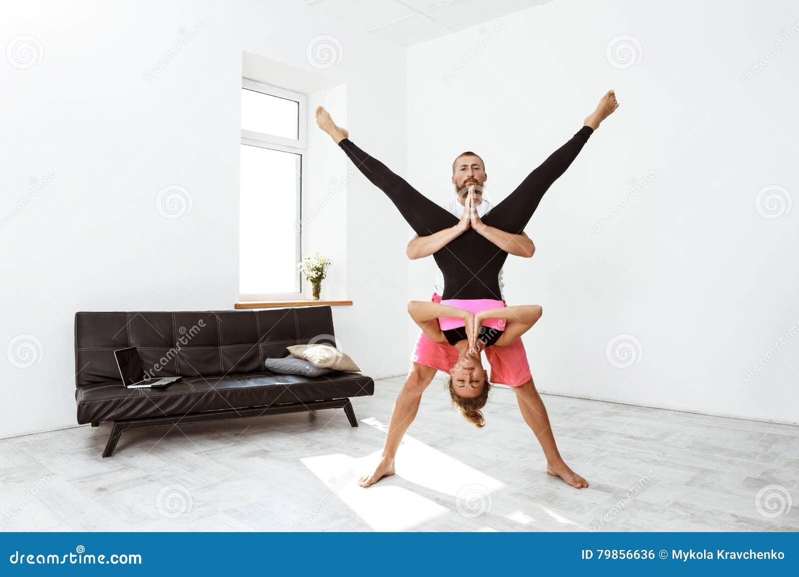 Young Beautiful Sportive Couple Practicing Partner Yoga Asanas At Home Stock Photo Image Of Female Joyful 79856636