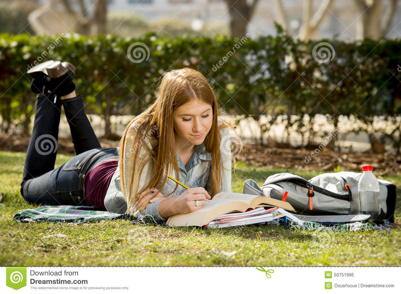 Young Beautiful Student Girl On Campus Park Grass With