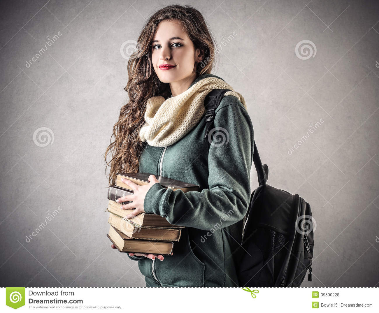 Young beautiful student with her books