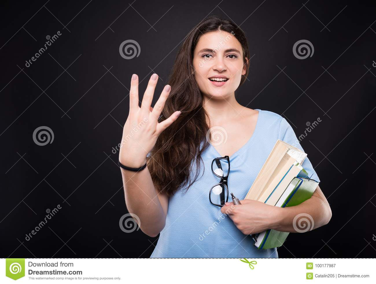 Young beautiful student woman counting four