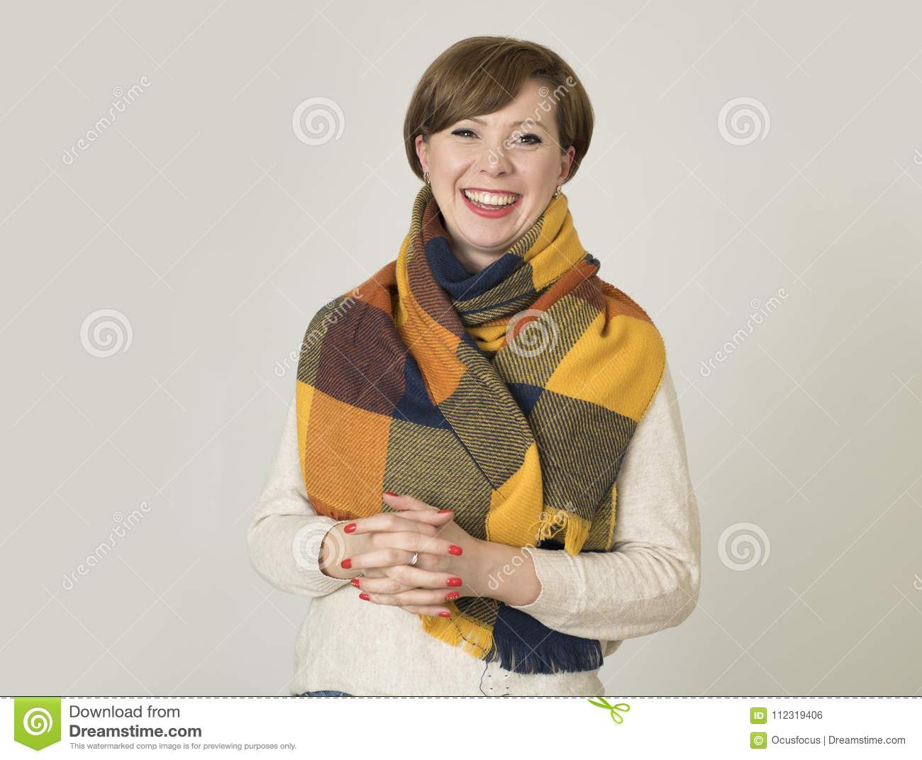 Young beautiful and stylish 30s red hair woman sweater and Autumn colorful scarf smiling happy