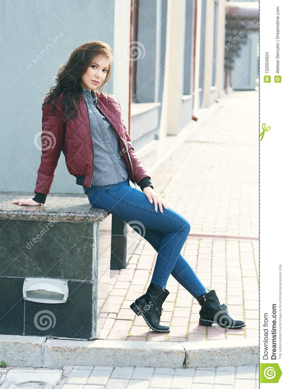 688a8d58c Young Beautiful Stylish Woman In A Burgundy Pilot`s Jacket And Blue ...