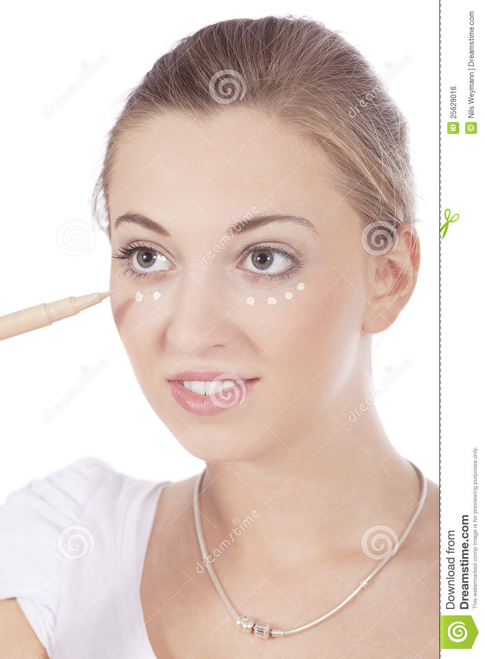 Young Beautiful Woman Applying Concealer On Face Stock Photo Image