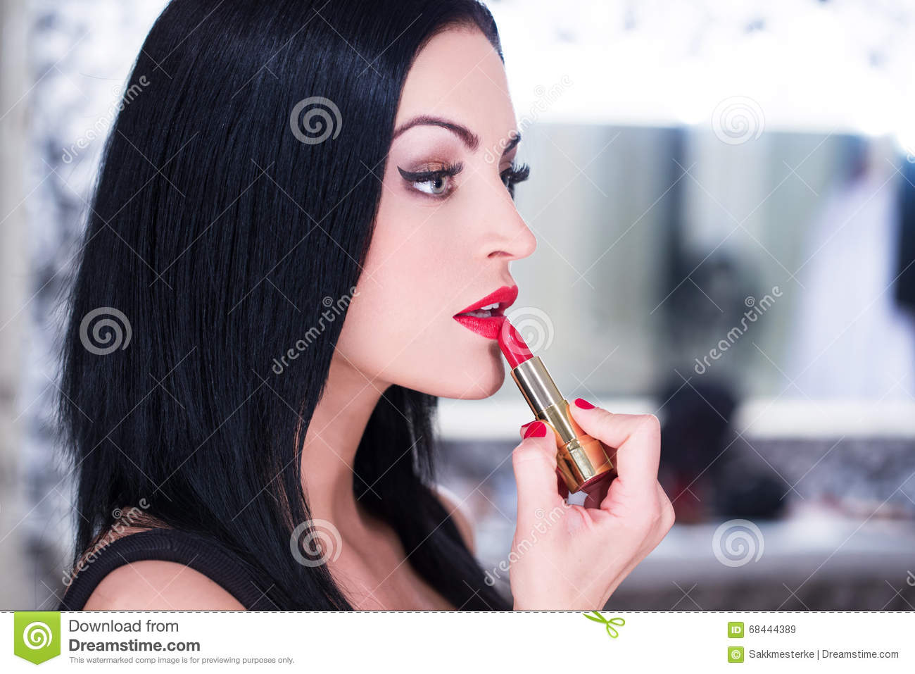 Young Beautiful Woman Applying Red Lipstick Royalty Free