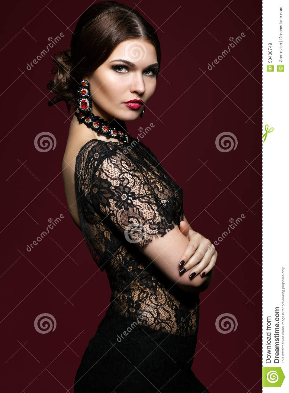 Young Beautiful Woman In Black Dress On Marsala Color