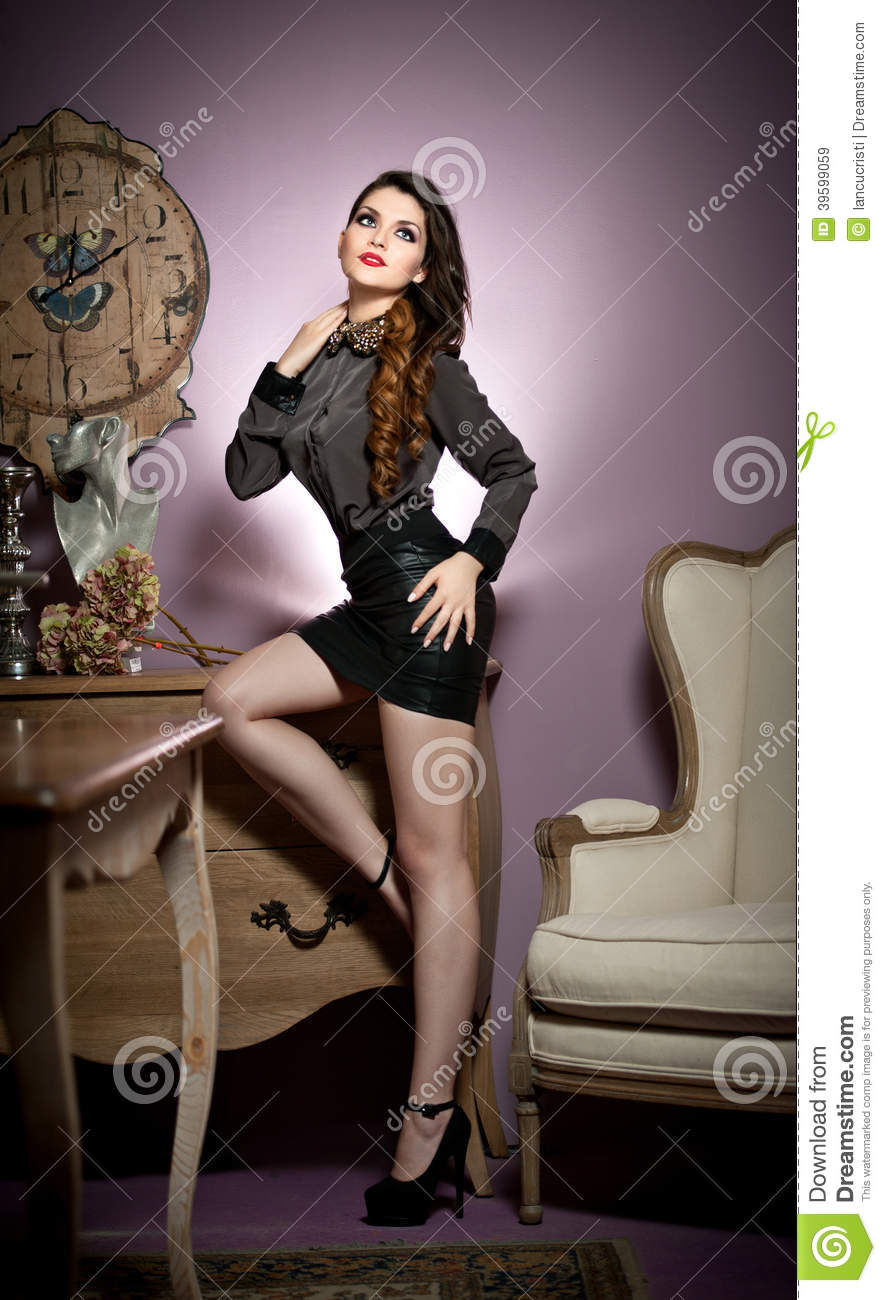 Young Beautiful Woman In Black In A Vintage Room Stock