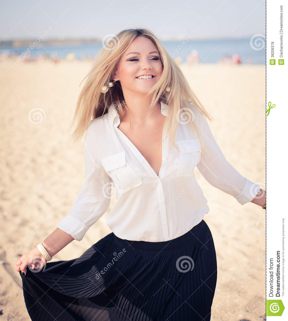 Black Fashion Models Poses: Young Beautiful Woman Blonde Poses On A Beach Stock Photo