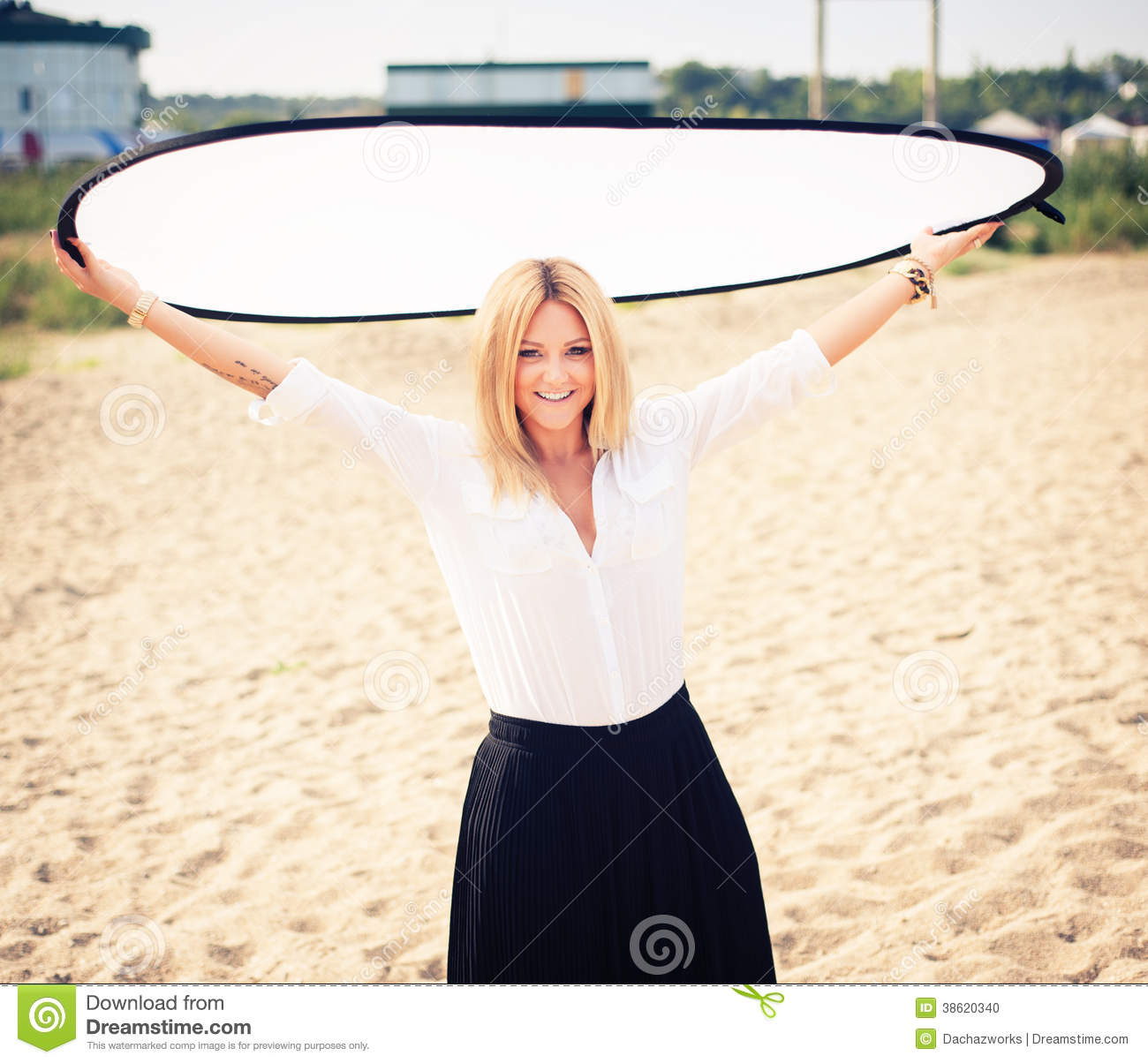 Young Beautiful Woman Blonde Poses On A Beach Stock Photo