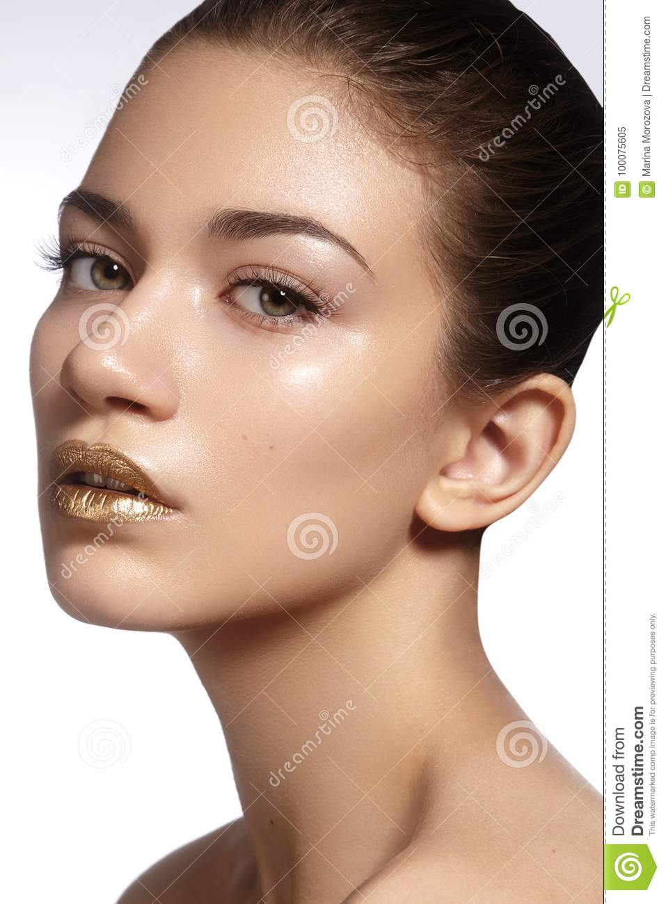 Young Beautiful Woman With Clean Soft Skin Bright Gold Lips Makeup