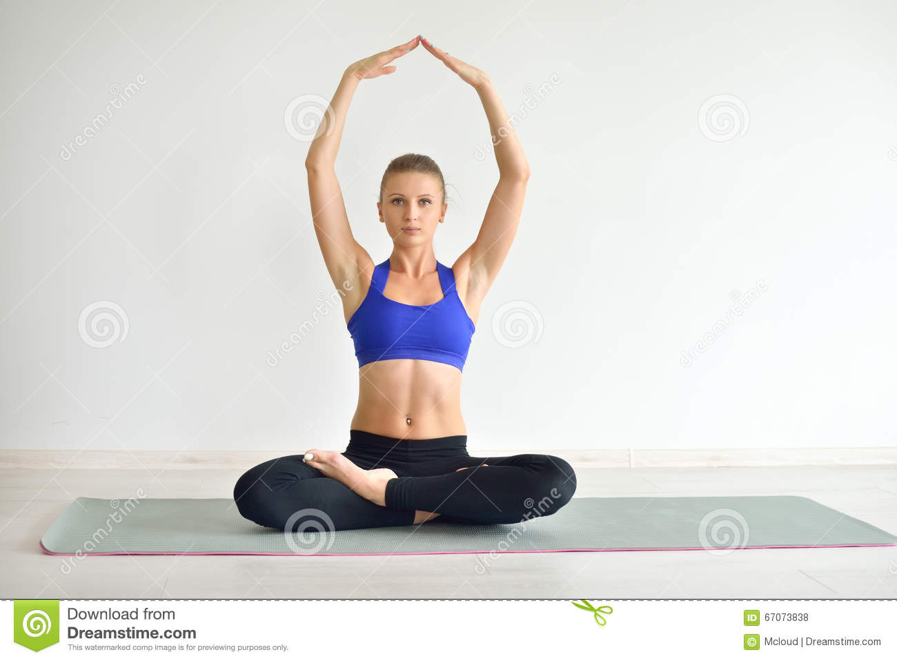 Young Beautiful Woman Doing Yoga Poses Indoor On Grey Background