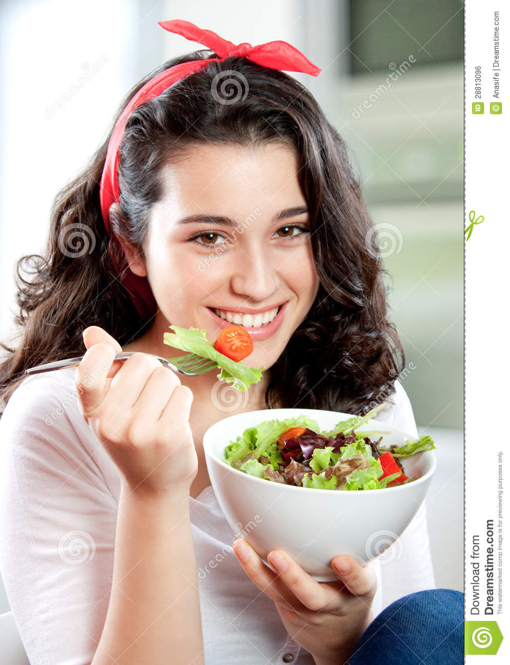 Beautiful Eat In Kitchens: Cute Young Woman Eating Tomato Royalty-Free Stock Image
