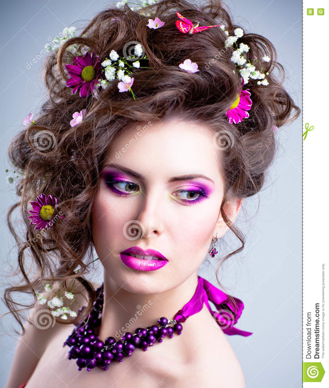 Beautiful Young Girl With Dark Hair And Bright Makeup