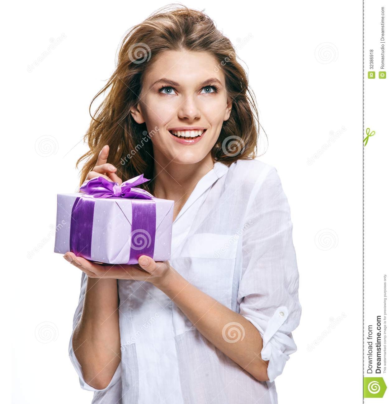 Young beautiful woman with gift in box isolated on white background